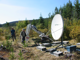 Nechako Seismic Station RAMB, showing typical station layout, with solar panels and satellite dish.  Photo courtesy of J. Cassidy.